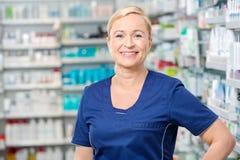 Smiling Female Chemist Standing In Pharmacy Stock Images