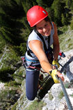 Smiling female climber. Young smiling woman climbing in the nature Royalty Free Stock Image