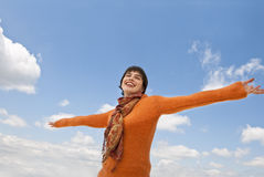 Smiling Female and Clouds Stock Photography