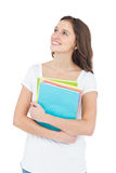 Smiling female college student holding books Royalty Free Stock Photography