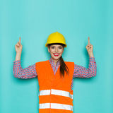 Smiling Female Construction Worker Pointing Up Royalty Free Stock Photo