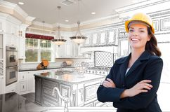 Smiling Female Contractor Over Kitchen Drawing Gradating to Photo royalty free stock photos