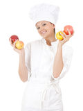 Smiling female cook with apples Royalty Free Stock Photos