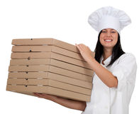 Smiling female cook with boxes of pizza Stock Photo