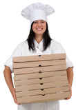 Smiling female cook with boxes of pizza Royalty Free Stock Image