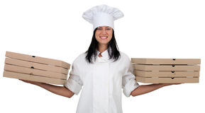 Smiling female cook with boxes of pizza Stock Images
