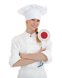 Smiling female cook keeping stopping sign Royalty Free Stock Images