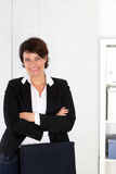 Smiling female corporate executive Stock Photos