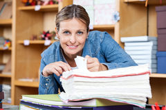 Smiling Female Customer Analyzing Papers Stock Image