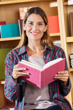 Smiling Female Customer Holding Notebook In Store Stock Photos
