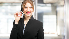 Smiling female customer representative portrait Royalty Free Stock Photo