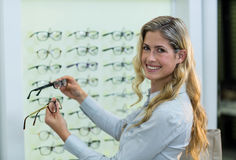 Smiling female customer selecting spectacles Royalty Free Stock Photo