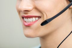 Smiling Female Customer Service Agent Wearing Stock Photo
