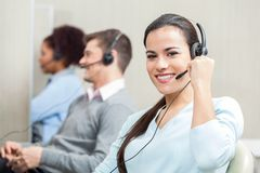 Smiling Female Customer Service Executive Working Stock Photos