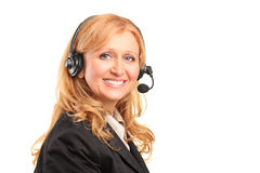 Smiling female customer service operator. A smiling female customer service operator with a headset isolated against white background Royalty Free Stock Photography