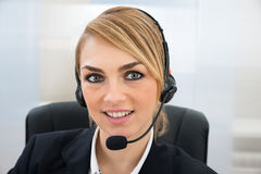 Smiling Female Customer Service Representative Royalty Free Stock Images