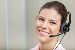 Smiling Female Customer Service Representative Stock Image