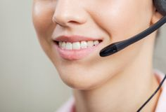 Smiling Female Customer Service Representative Royalty Free Stock Photography