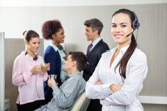 Smiling Female Customer Service Representative Royalty Free Stock Photo