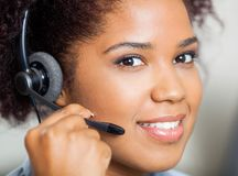 Smiling Female Customer Service Representative Stock Photography