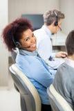 Smiling Female Customer Service Representative In Stock Image