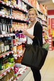 Smiling Female Customer Standing In Grocery Store Royalty Free Stock Image
