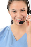 Smiling female customer support phone operator Royalty Free Stock Photos