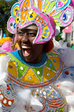 Smiling female dancer dressed in huge pink headdress, dances in Junkanoo Stock Photography