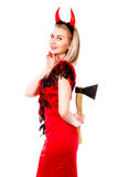 Smiling female demon with an axe behind her back Royalty Free Stock Photos