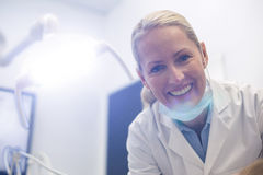 Smiling female dentist in dental clinic Stock Photography