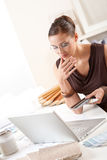 Smiling female designer with color swatch. And laptop at office royalty free stock photo