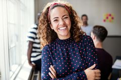 Free Smiling Female Designer Standing In An Modern Office Royalty Free Stock Photo - 136832705