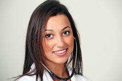 Smiling female doctor. Pretty female doctor, smiling face closeup in horizontal with copy space Royalty Free Stock Photo