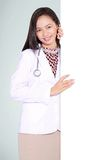 A smiling female doctor with a blank board Stock Photo