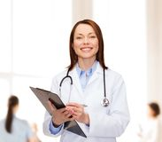 Smiling female doctor with clipboard Royalty Free Stock Photo