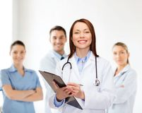 Smiling female doctor with clipboard Stock Photo