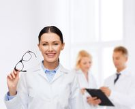 Smiling female doctor with eyeglasses Stock Photos