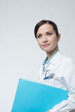 Smiling female doctor with file Royalty Free Stock Photo