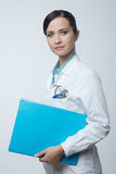 Smiling female doctor with file Stock Image