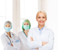 Smiling female doctor with group of medics Royalty Free Stock Photo