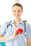 Smiling female doctor with heart an stethoscope Stock Photography