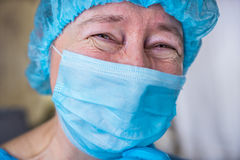 Smiling female doctor in hospital hallway Royalty Free Stock Photos