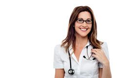 Smiling female doctor, isolated over white Stock Photography