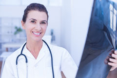 Smiling female doctor looking at camera royalty free stock photos