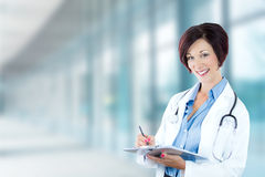Smiling female doctor medical professional in hospital stock photos