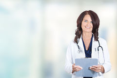 Smiling female doctor medical professional standing in hospital royalty free stock photography