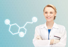 Smiling female doctor with molecule of serotonin Royalty Free Stock Photos