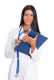 Smiling female doctor with notepads Stock Photos