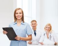 Smiling female doctor or nurse with clipboard Royalty Free Stock Photo