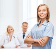 Smiling female doctor or nurse Stock Images